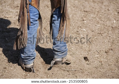 Boots,spurs,chaps and jeans