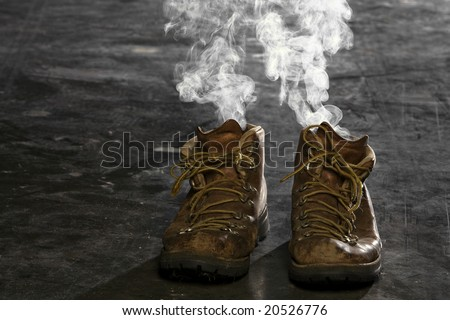 Boots with smoke coming from them - stock photo