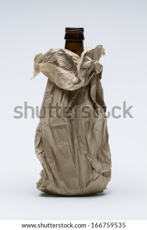 Booze in paper bag, vertical - stock photo