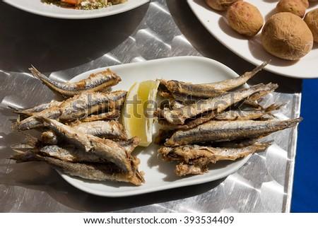 Boquerones fritos and papas arrugadas - Spanish fried anchovies. Delicious tapas typical of Canary Island   - stock photo
