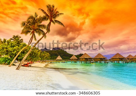 Bora Bora, French Polynesia. Otemanu mountain, beach and palm trees. - stock photo