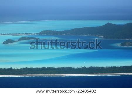 bora bora island south part with resorts - stock photo
