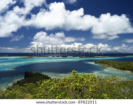 Bora Bora Lagoon with Raiatea and Tahaa in Background From Above on a Sunny Day, 40 MPixel native resolution - stock photo