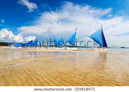 Boracay Island, Philippines - JULY 29, 2015: Sailing boats (paraw) at the famous White Beach