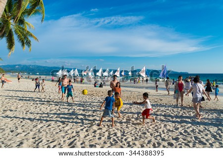 BORACAY, PHILIPPINES - MAY 19, 2015: Unknown local children playing football on the famous boracay white beach - stock photo