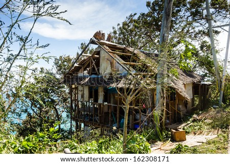 BORACAY, PHILIPPINES - NOVEMBER 9 2013: A wooden shack is completely destroyed by the passage of Super Typhoon Haiyan in the Philippines - stock photo