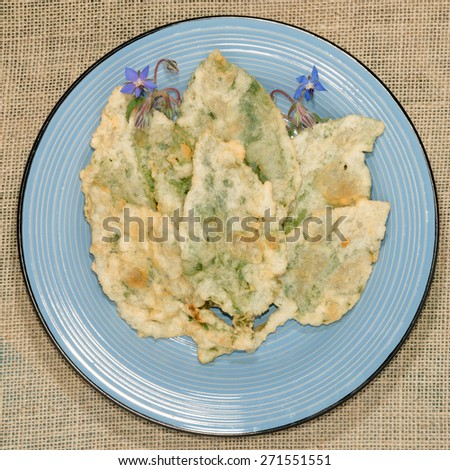Borage leaves fried in batter, traditional Italian cuisine - stock photo