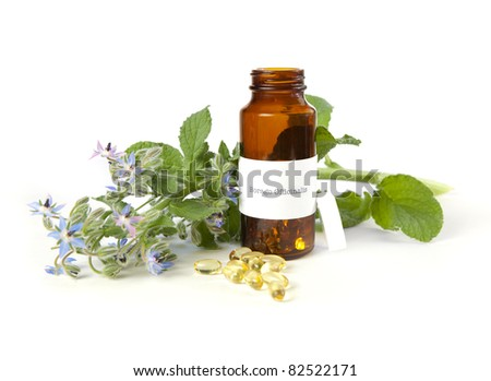 Borage oil, Borago Officinalis. The label was made for the photo shoot, no trademark or brand name copyright infringement issues. - stock photo