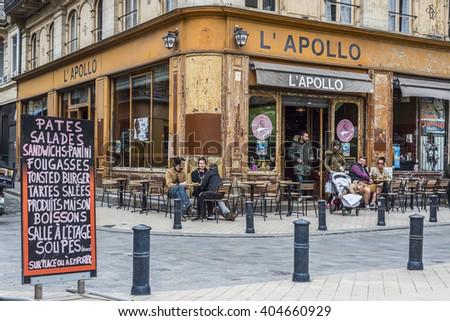 Bordeaux, France - March 25, 2016. People in the bar terrace of Apollo cafe in Place Fernand Laffargue square, Bordeaux. Aquitaine. France. - stock photo