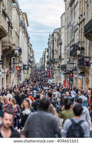 Bordeaux, France - March 27, 2016. People walking in Rue Sainte Catherine, the main shopping street in Bordeaux. - stock photo