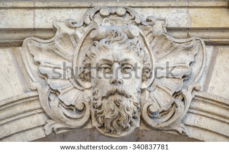 BORDEAUX, FRANCE, November 15, 2015: Place GABRIEL, The 32nd of 32 head statues sculptures on the top of the Palais de la Bourse historic building.