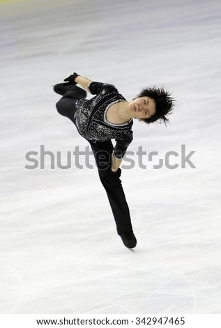 BORDEAUX, FRANCE - NOVEMBER 13, 2015: Shoma UNO of Japan performs short program during the official training at Trophee Bompard ISU Grand Prix at Patinoire Meriadeck Arena. - stock photo