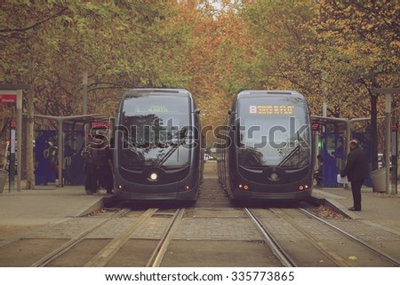 BORDEAUX, FRANCE- October 5 2015: Tram is passing by the Place des Quinconces and colorful autumn trees in Bordeaux, France,  - stock photo
