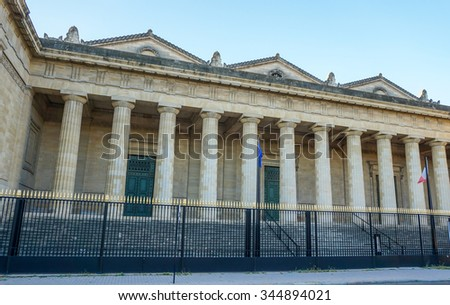 "Bordeaux, France, September 03, 2015 : Entrance of Bordeaux main courthouse ""Palais de Justice"", situated Place de la Republique with twelve huge columns."