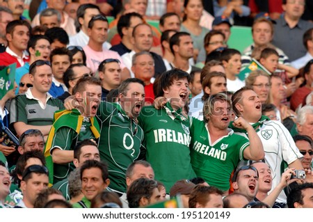 BORDEAUX, FRANCE-SEPTEMBER 09, 2007: irish fans cheering during the match Ireland vs Namibia, of the Rugby World Cup, France 2007, in Bordeaux. - stock photo