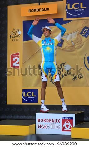 BORDEAUX - JULY 23: Cyclist Alberto Contador is on the podium of 18 stage of Tour de France 2010, July 23, 2010 Tour de France in Bordeaux. - stock photo