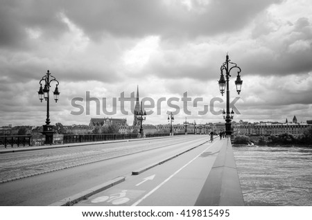 Bordeaux river bridge with St Michel cathedral, France