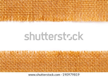 border fabric texture of torn linen sacking cloth, ripped edge of hessian coarse scrap  - stock photo
