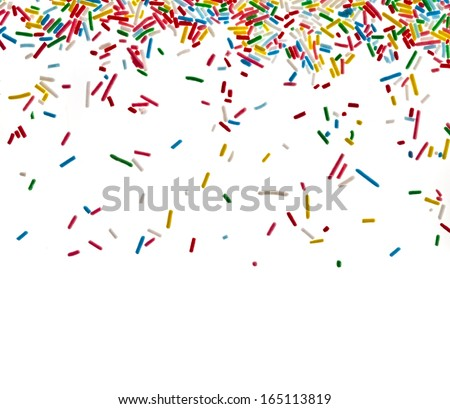 Border frame of colorful sprinkles isolated on white background card for text - stock photo