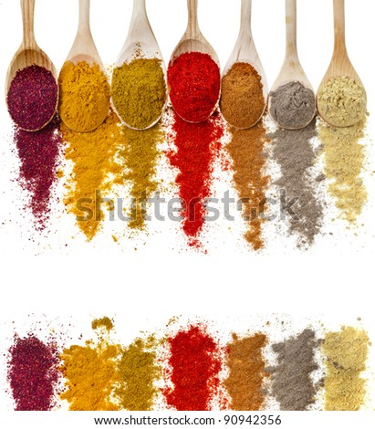 border frame of powder spices on spoons close up macro shot, isolated on a white background - stock photo