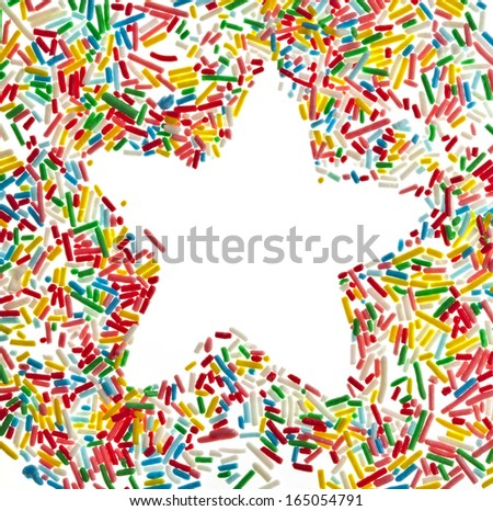 Border frame star of colorful sprinkles top view close up isolated on white background card for text