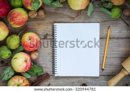 Border from apples, pears and walnuts on old wooden table. Holiday cooking background. Food background - stock photo
