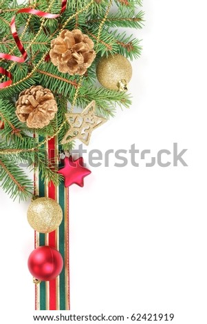 Border from fir branches with cones, baubles,star and streamers. - stock photo
