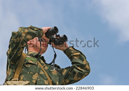 Border guards in the stands with binoculars - stock photo
