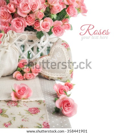 Border image with many pink roses and stuffed heart on white background. Space for your text or greeting on the right. Design for an Anniversary, Mother's day or St. Valentine.  - stock photo