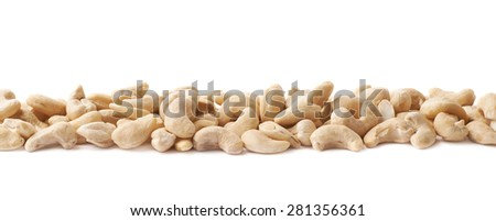 Border line of cashew nuts seeds isolated over the white background - stock photo