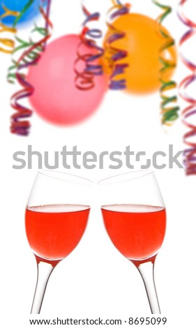 Border made from colorful balloons  confetti  and a drink isolated on white background. focus on glasses