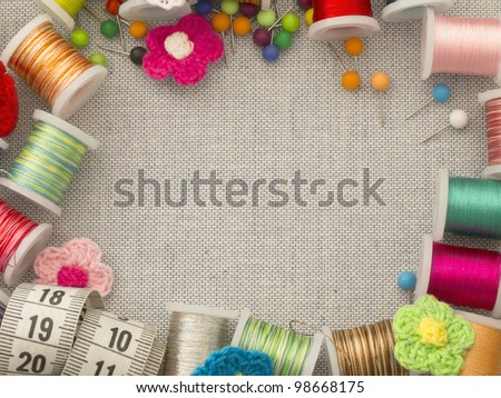 border made of bobbins and other sewing materials - stock photo