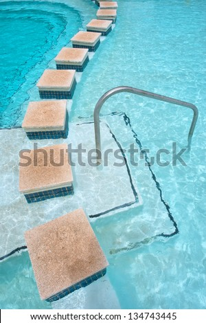 Border of a pool in hot springs spa. Shot in Montagu, Western Cape, South Africa. - stock photo