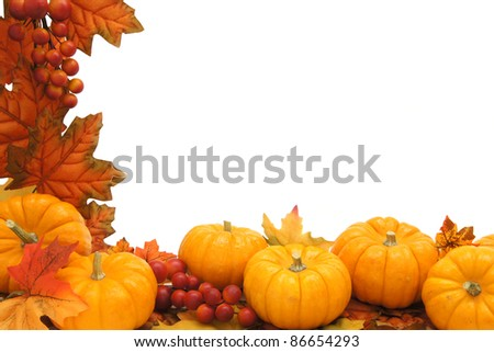 Border of autumn leaves and pumpkins over white