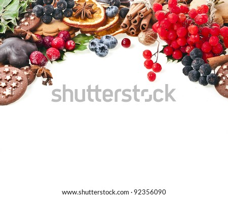 border of christmas cookie , fresh berries , fruits, xmas spices on a white background - stock photo