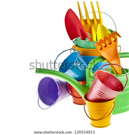 Border of Colorful Gardening Tools : Watering can, bucket, spade over white background - stock photo