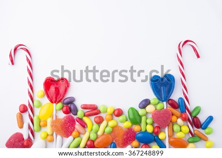 Border of colorful jelly candies on white - stock photo