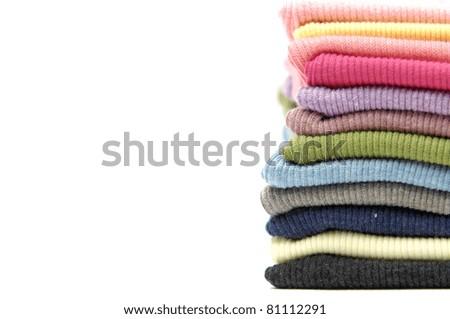 Border of Colorful shirts freshly folded from the laundry - stock photo