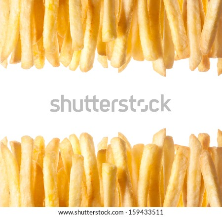 Border of crisp golden French Fries arranged in two rows along the top and bottom of the frame isolated on white with copyspace between - stock photo