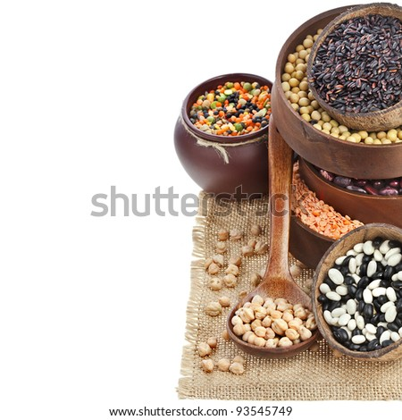 border of  lentils, beans, peas, soybeans, legumes in sackcloth napkin on white  background - stock photo