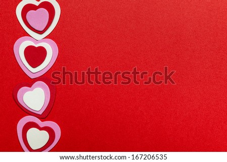 Border of romantic red pink and white hearts for Valentines day on crimson background - stock photo