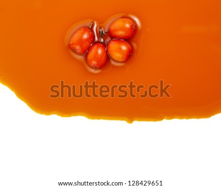 Border of sea-buckthorn oil pouring texture, isolated on the white background - stock photo