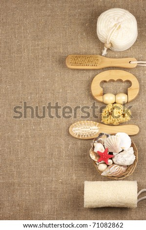 Border of SPA accessories on burlap. Top view, flat lay.