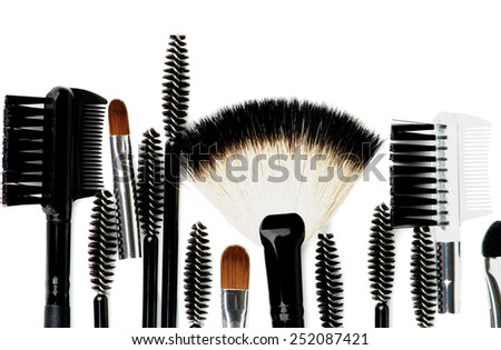 Border of Various Make-up Brushes and Applicators closeup on white background - stock photo
