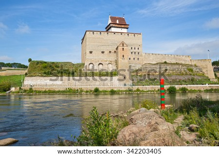 Border post on the border between Russia and Estonia on the River Narva.  - stock photo
