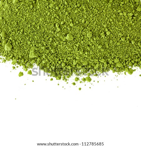 border surface close up of powdered green tea  isolated on white background - stock photo