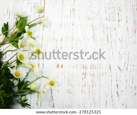 Border with Anemone flowers on a wooden background - stock photo