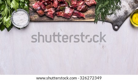 border with Fresh raw sliced lamb meat cleaver oil salt herbs on white wooden rustic background banner for website  space for text - stock photo