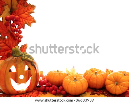 Border with jack-o-lantern and fall leaves with white background - stock photo