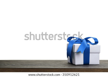 border with white gift box with blue ribbon bow, holiday template - stock photo